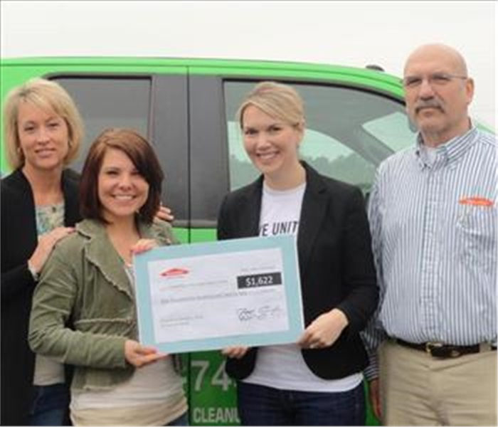United Way Receives Donation From SERVPRO